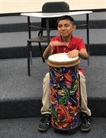 Fifth grader playing drum