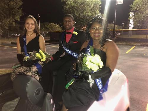 Several students of homecoming court after the game