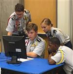 JROTC students working on computer during competition