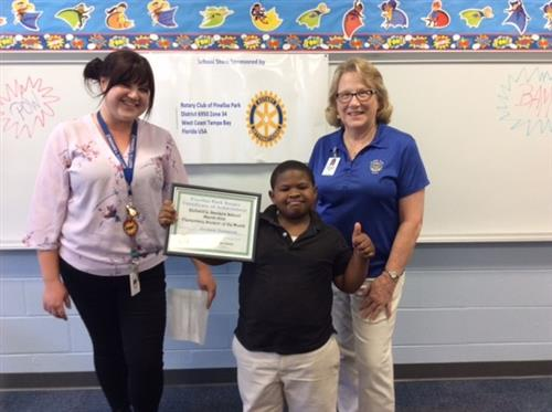 An elementary student winning Student of the Month award.