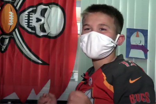 Cypress Woods Elementary students make spirit bracelets for the Tampa Bay Buccaneers