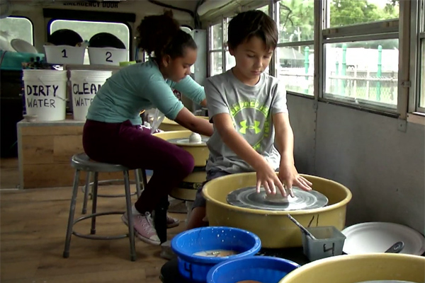Southern Oaks Elementary students work with clay