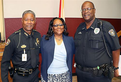 Pictured left to right: Schools Police Chief Luke Williams, Stacey Hawkins (wife) and Officer Michael Hawkins.
