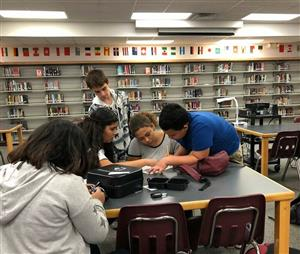 Students working on activity in the media center