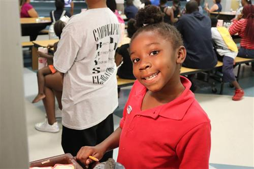 Campbell Park Elementary student smiles at Community School showcase.