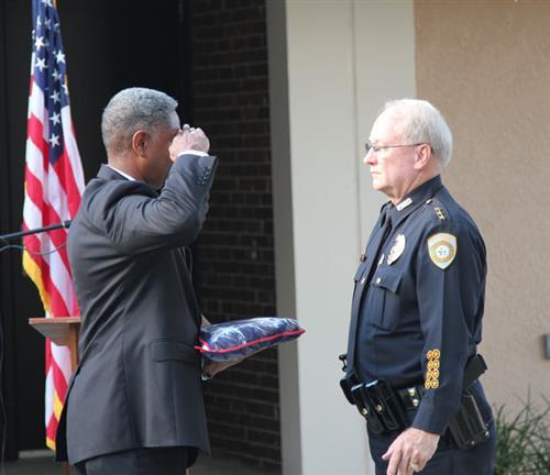 Luke Williams salutes outgoing Chief Rick Stelljes.