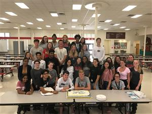 Senior NHS students with cake