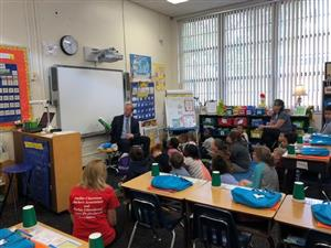 Dr. Grego reads to a class