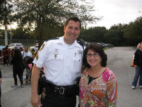 Mrs. Buckles & Officer at Walk and Roll to School